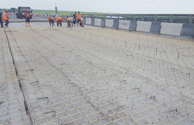 Применение стеклопластиковой арматуры в дорожном строительстве